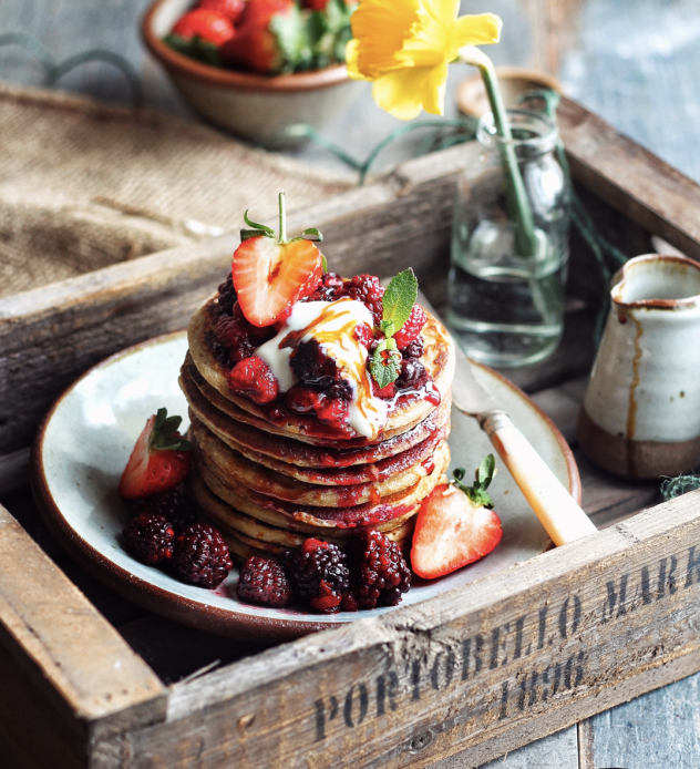 vegan stack of banana pancakes topped with strawberries